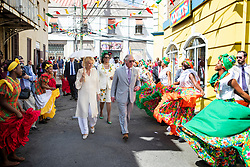 The Prince of Wales and the Duchess of Cornwall watch dancers during a walkabout through the streets of St George's during a one day visit to the Caribbean island of Grenada.