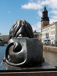 Bronze lion guarding canal in central Gothenburg Sweden