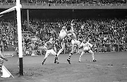 Kerry backs attempt to prevent Tyrone from getting a goal during the All Ireland Minor Gaelic Football Final, Tyrone v Kerry in Croke Park on the 28th September 1975.<br /> <br /> The rules for hurling were published in United Ireland on 7 February 1885, by the Gaelic Athletic Association. GAA .<br /> <br /> those for weight-throwing on 14 February, and those for athletics (also given below) and for GAA sports in general, were published on 21 February.<br />  <br />  <br /> HURLING<br /> <br /> 1. The ground shall, when convenient, be at least 200 yards long by 150 yards broad, or as near to that size as can be got.<br /> 2. There shall be boundary lines all around the ground, at a distance of at least five yards from the fence.<br /> 3. The goal shall be two upright posts, twenty feet apart, with a cross-bar ten feet from the ground. A goal is won when the ball is driven between the posts and under the cross-bar.<br /> 4. The ball is not to be lifted off the ground with the hand, when in play.<br /> 5. There shall not be less than fourteen or more than twenty-one players at the side in regular matches.