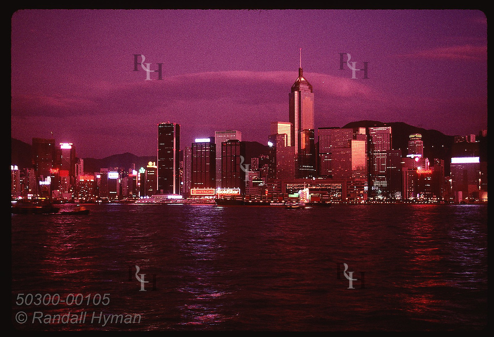 Central Plaza, 4th tallest bldg in world, reflects evening sky; view of Hong Kong from Kowloon. Hong Kong