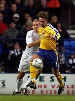 Photo. Jed Wee.<br /> Bolton Wanderers v Southampton, FA Barclaycard Premiership, Reebok Stadium, Bolton. 08/11/03.<br /> Southampton's Claus Lundekvam (R) holds off Bolton's Kevin Davies.