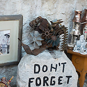 "MOSTAR, BOSNIA AND HERZEGOVINA - JUNE 28:  A ""Don't Forget Sign"" is seen on June 28, 2013 in Mostar, Bosnia and Herzegovina. The Siege of Mostar reached its peak and more cruent time during 1993. Initially, it involved the Croatian Defence Council (HVO) and the 4th Corps of the ARBiH fighting against the Yugoslav People's Army (JNA) later Croats and Muslim Bosnian began to fight amongst each other, it ended with Bosnia and Herzegovina declaring independence from Yugoslavia.  (Photo by Marco Secchi/Getty Images)"