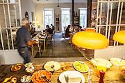 "Guests having breakfast at the basement room at ""Casa das Janelas com Vista"", an hotel in Bairro Alto district, in Lisbon, Portugal."