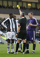 Photo: Steve Bond/Richard Lane Photography. West Bromwich Albion v Newcastle United. Barclays Premiership. 07/02/2009. Leon Barnett (L) and Kevin Nolan (R) are shown a yellow card from ref Mr Foy