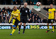 Referee Martin Atkinson watches on as Adlene Guedioura of Watford clears during the FA Cup match at The Den, London<br /> Picture by Liam McAvoy/Focus Images Ltd 07413 543156<br /> 29/01/2017