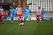 Stevenage midfielder Chris Lines(40) plays a pass  during the EFL Sky Bet League 2 match between Stevenage and Cheltenham Town at the Lamex Stadium, Stevenage, England on 20 April 2021.