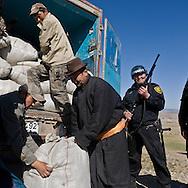 Mongolia. Ulaanbaatar. the armed guards of EAGLE security company protect the convoy of  cashmere, the value of a truck full of cashmere wool is more than one million US dollars    -  / la societe de securite EAGLE avec gardes armes protegent les damions qui parcourent la steppe.  le cachemire brut est vendu 40 $ le kilo , un camion de 40 tonnes represente plus d'un million de dollars   - Mongolie /