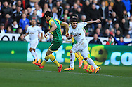 Alberto Paloschi of Swansea city ®  looks to go past Russell Martin (L) of Norwich city. Barclays Premier league match, Swansea city v Norwich city at the Liberty Stadium in Swansea, South Wales  on Saturday 5th March 2016.<br /> pic by  Andrew Orchard, Andrew Orchard sports photography.