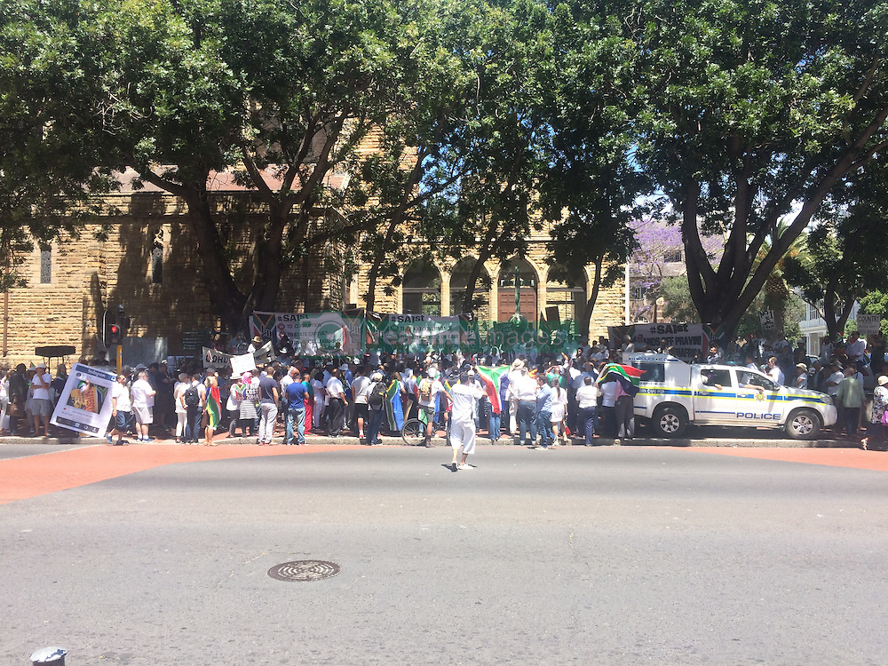 Wednesday 2nd October 2016.<br /> St. George's Cathedral,<br /> Cape Town,<br /> Western Cape,<br /> South Africa.<br /> <br /> #SaveSouthAfrica Community Protest In Cape Town!<br /> <br /> Concerned Religious Leaders and other South Africans gathered together for a community protest in support of the call to #SaveSouthAfrica from 'the acute social crisis that has been brought about by corruption, mismanagement and political intrigue' as reported nationwide in the news. The campaign was formed under the banner of holding government leaders accountable to the Constitution and the values they have pledged to uphold as representatives of the people. The #SaveSouthAfrica Community Protest walked from St. George's Cathedral to the National Prosecuting Authorities office in Cape Town, South Africa on Wednesday 2nd November 2016.<br /> <br /> Picture By:  Ross Hastie / RealTime Images.