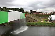 London 2012 Olympic Park in Stratford, East London. The River Lea runs underneath a major bridge. Once a contaminated waterway, this is now a clean and fresh part fo the landscape.