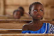 A girl listens during class at the Podio primary school in the village of Podio, Bas-Sassandra region, Cote d'Ivoire on Friday March 2, 2012.