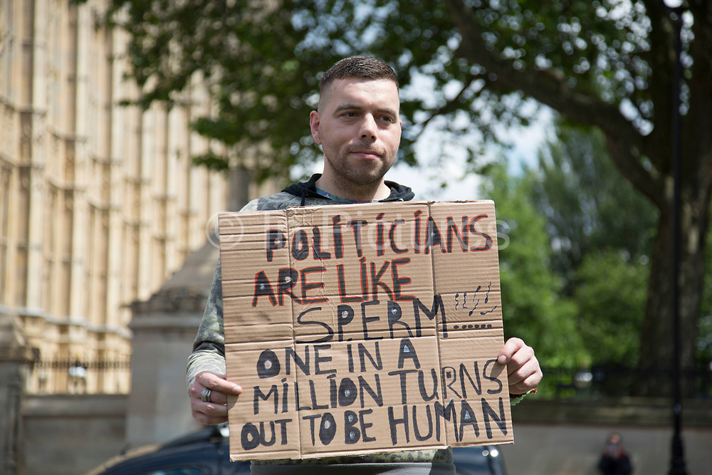 Protester with his placard at College Green in Westminster outside the Houses of Parliamant following a Leave vote, also known as Brexit as the EU Referendum in the UK votes to leave the European Union on June 24th 2016 in London, United Kingdom. Membership of the European Union has been a topic of debate in the UK since the country joined the EEC, or Common Market in 1973. It will be the second time the British electorate has been asked to vote on the issue of Britains membership: the first referendum being held in 1975, when continued membership was approved by 67% of voters. The two sides are the  Leave Campaign, commonly referred to as a Brexit, and those of the Remain Campaign who are also known as the In Campaign.