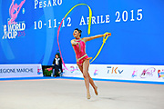 Filiou Varvara during qualifying at ribbon in Pesaro World Cup 11 April 2015. Varvara, born  on 29 December 1994 in Maurosi,Greece. She is the most famous and awarded Greek athlete of this sport. Varvara is an 8 time Greek National All-around Champion.