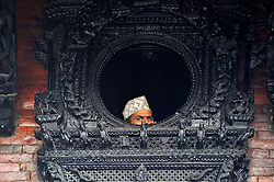 September 15, 2016 - Kathmandu, NE, Nepal - A Nepalese devotees observing festival from the traditional window on the third day of Indra Jatra Festival celebrated at Basantapur Durbar Square, Kathmandu, Nepal on Thursday, September 15, 2016. Devotees celebrated the god of rain 'Indra' for 8 days in Kathmandu. (Credit Image: © Narayan Maharjan/NurPhoto via ZUMA Press)