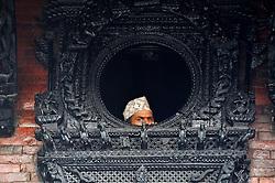 September 15, 2016 - Kathmandu, NE, Nepal - A Nepalese devotees observing festival from the traditional window on the third day of Indra Jatra Festival celebrated at Basantapur Durbar Square, Kathmandu, Nepal on Thursday, September 15, 2016. Devotees celebrated the god of rain 'Indra' for 8 days in Kathmandu. (Credit Image: © Narayan Maharjan/NurPhoto via ZUMA Press)