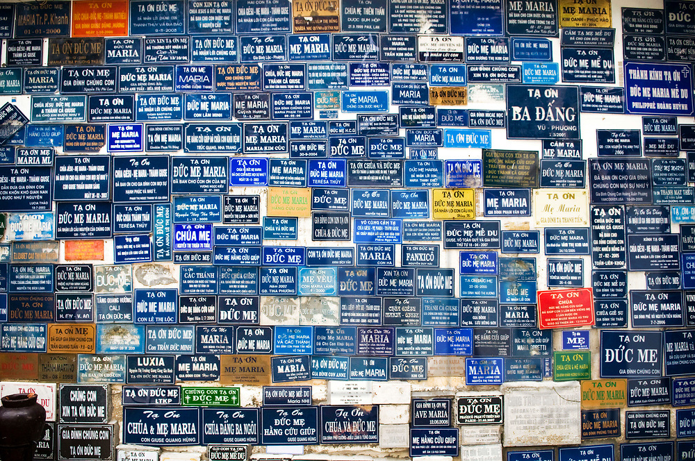 Wall covered with plates filled of thanks messages. Huyen Sy Church, Ho Chi Minh city, Vietnam, Southeast Asia