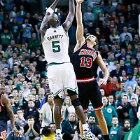 18 January 2013: Boston Celtics power forward Kevin Garnett (5) takes a jumpshot over Chicago Bulls center Joakim Noah (13) during the Chicago Bulls 100-99 overtime victory over the Boston Celtics at the TD Garden, Boston, Massachusetts, USA.