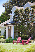 Two Red Adirondack Chairs on the Front Yard Lawn