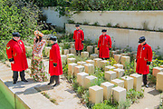 Bruna Miranda in a flower dress on the M&G garden with Chelsea Pensioners - The Chelsea Flower Show organised by the Royal Horticultural Society with M&G as its MAIN sponsor for the final year.