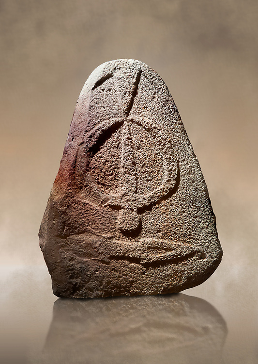 Late European Neolithic prehistoric Menhir standing stone with carvings on its face side. The representation of a stylalised male figure starts at the top with a long nose from which 2 eyebrows arch around the top of the stone. below this is a carving of a falling figure with head at the bottom and 2 curved arms encircling a body above. at the bottom is a carving of a dagger running horizontally across the menhir. Excavated from Piscina 'E Sali II site,  Laconi. Menhir Museum, Museo della Statuaria Prehistorica in Sardegna, Museum of Prehoistoric Sardinian Statues, Palazzo Aymerich, Laconi, Sardinia, Italy. Warm art  background.<br /> <br /> Visit our PREHISTORIC PLACES PHOTO COLLECTIONS for more  photos to download or buy as prints https://funkystock.photoshelter.com/gallery-collection/Prehistoric-Neolithic-Sites-Art-Artefacts-Pictures-Photos/C0000tfxw63zrUT4