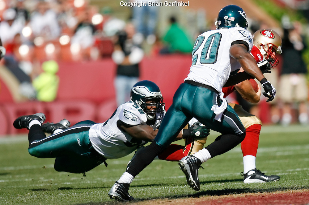 12 Oct 2008: Philadelphia Eagles defensive end Trent Cole #58 makes a tackle while FS Brian Dawkins #20 moves into assist during the game against the San Francisco 49ers on October 12th, 2008. The Eagles won 40-26 at Candlestick Park in San Francisco, California.