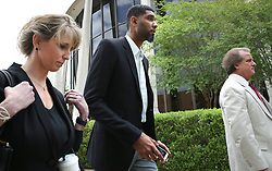 June 28, 2017 - San Antonio, Texas, U.S. - Retired Spurs player TIM DUNCAN, center, leaves the John H. Wood Jr. Federal Courthouse with his current financial advisor Wendy Kowalik, left, after the sentencing of his former financial advisor Charles Banks. (Credit Image: © San Antonio Express-News via ZUMA Wire)