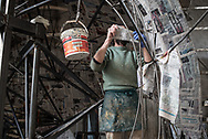 At work on papier-mache in the hangar of Fabrizio Galli inside the Cittadella del Carnevale