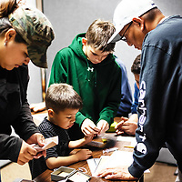 The Peralto and Helfenbein families work together to get out of the escape room the Octavia Fellin Public Library put on Saturday in Gallup.