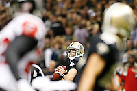 NEW ORLEANS, LA - NOVEMBER 11:  Drew Brees #9 of the New Orleans Saints looks downfield for a receiver against the Atlanta Falcons at Mercedes-Benz Superdome on November 11, 2012 in New Orleans, Louisiana.  The Saints defeated the Falcons 31-27.  (Photo by Wesley Hitt/Getty Images) *** Local Caption *** Drew Brees Sports photography by Wesley Hitt photography with images from the NFL, NCAA and Arkansas Razorbacks.  Hitt photography in based in Fayetteville, Arkansas where he shoots Commercial Photography, Editorial Photography, Advertising Photography, Stock Photography and People Photography