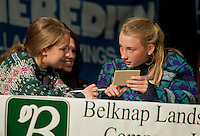 "The ""Ugly Sweaters"" team of GHS students Lauren Pereira, Brianna Bowen and Katherine Rice (sponsored by Gregg and Sandra Caulfield) work their way though to the final round of the annual LRSF Spelling Bee winning first place Thursday evening at Laconia High School.  (Karen Bobotas/for the Laconia Daily Sun)"
