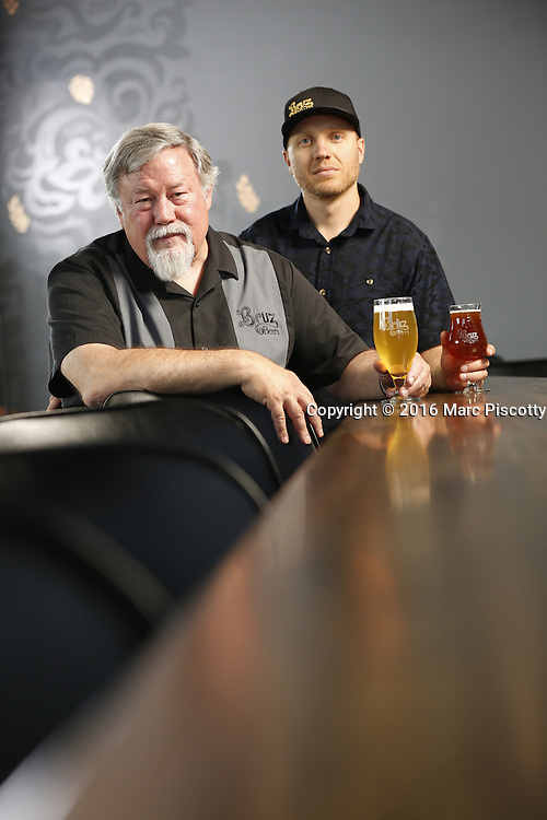 SHOT 7/22/16 2:03:55 PM - Bruz Beers co-founders Charlie Gottenkieny and Ryan Evans inside the new brewery near 67th Avenue and Pecos in Denver, Co. Bruz Beers is Denver's artisanal Belgian-style brewery, featuring a full line of traditional and Belgian-inspired brews, hand-crafted in small batches. Includes images of Evan's dog 'Cooper' as well who serves as the brewery dog. (Photo by Marc Piscotty / © 2016)