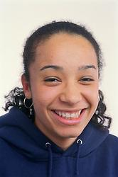 Portrait of teenage girl smiling,