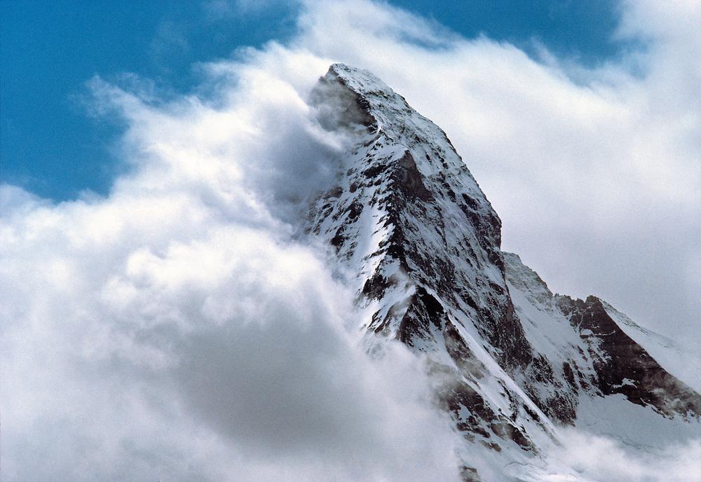 Clouds swirl around the Matterhorn above Zermatt, in the Valiasian Alps in Switzerland. ©Ric Ergenbright