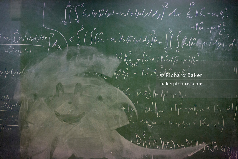 Mathematical formulae on a blackboard at the Centre for Mathematical Sciences at the University of Cambridge.