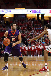 15 January 2016: Mislav Brzoja(10) keeps his dribble and looks past Tony Wills(12) during the Illinois State Redbirds v Evansville Purple Aces at Redbird Arena in Normal Illinois (Photo by Alan Look)