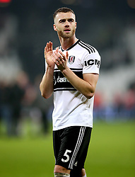 Fulham's Calum Chambers applauds the fans at the end of the Premier League match at London Stadium.