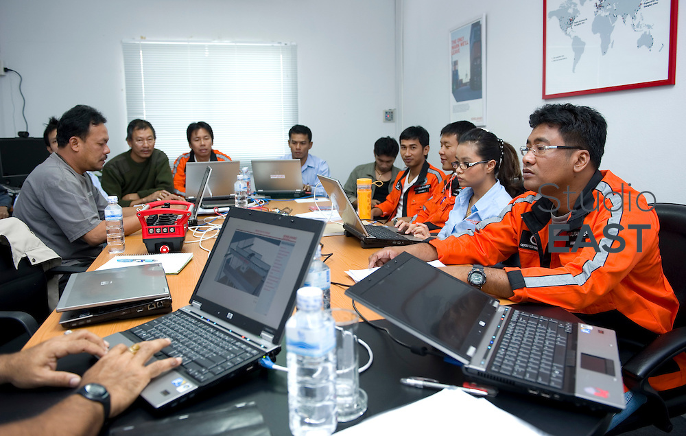 Employees follow a training session in KoneCranes' offices in Pinthong Industrial Park, near Sriracha, Thailand, on November 10, 2010. Photo by Lucas Schifres/Pictobank