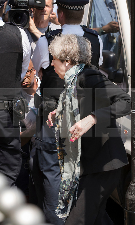 © Licensed to London News Pictures. 19/06/2017. London, UK. Prime Minister Theresa May stumbles and loses a shoe as she arrives at Finsbury Park Mosque in north London where earlier a van ploughed into a crowd near Finsbury Park Mosque, as they finished taraweeh, Ramadan evening prayers. One person has been killed and 10 people are injured. Photo credit: Peter Macdiarmid/LNP