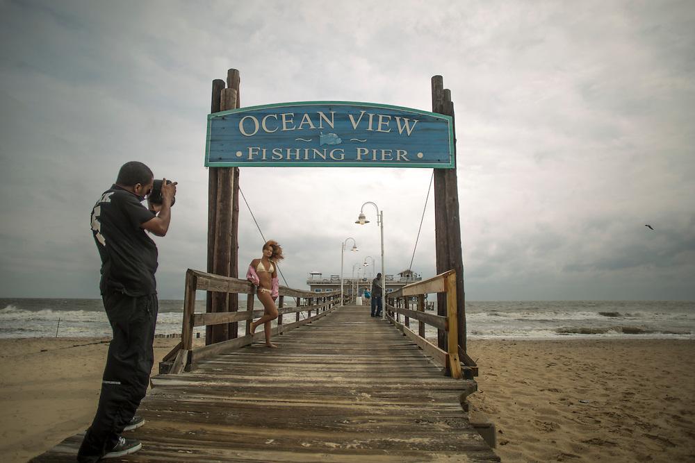 NORFOLK, VA - JULY 4: Kayla Cason, of Va. Beach, poses for photographer Dexter Cohen, of Chesapeake, Va., during a fashion shoot on Friday, July 4th, 2014 in Norfolk, Va. (Photo by Jay Westcott/For The Virginian-Pilot)