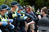 Chaos erupts as protesters move on police during the Melbourne Freedom Rally at The Shrine. Premier Daniel Andrews promises 'significant' easing of Stage 4 restrictions this weekend. This comes as only one new case of Coronavirus was unearthed over the past 24 hour and no deaths. (Photo by Dave Hewison/Speed Media)