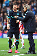 Manchester City Manager Manuel Pellegrini gives instructions to Aleksandar Kolarov of Manchester City. Barclays Premier league match, Stoke city v Manchester city at the Britannia Stadium in Stoke on Trent, Staffs on Saturday 5th December 2015.<br /> pic by Chris Stading, Andrew Orchard sports photography.