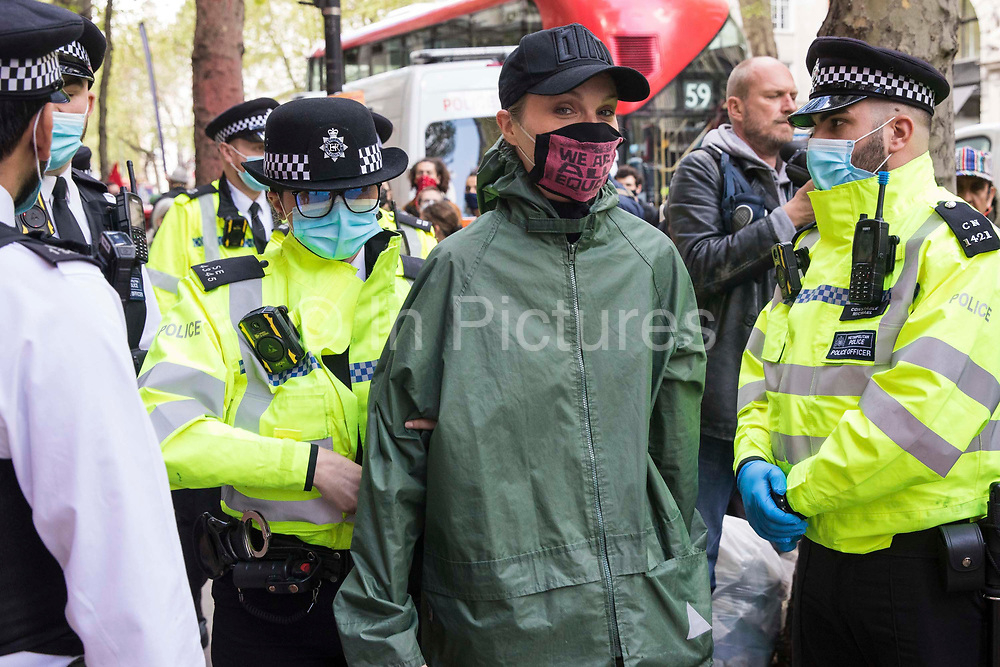 An activist from Palestine Action is taken by Metropolitan Police officers for a search during a protest outside the UK headquarters of Elbit Systems, an Israel-based company developing technologies used for military applications including drones, precision guidance, surveillance and intruder-detection systems, on 11th May 2021 in London, United Kingdom. The activists were protesting against the companys presence in the UK and in solidarity with the Palestinian people at a time of a significant rise in tension in Israel and the Occupied Territories following attempts at forced evictions of Palestinian families in the Sheikh Jarrah neighbourhood of East Jerusalem, the deployment of Israeli forces at the Al-Aqsa mosque and the killing of children in Gaza.
