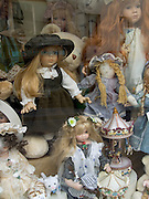 dolls in shop window