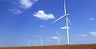 Wind mills  in a wheat farm near Ransom, Kansas on July 7, 2017<br /><br />Photo by Dennis Brack