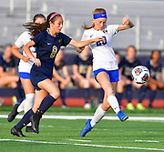 Columbia midfielder Ainsley Jacobus (right) passes the ball as Althoff midfielder Issy Wendler moves in. Althoff played Columbia in the sectional championship game at Althoff High School in Belleville, IL on Friday June 11, 2021. <br /> Tim Vizer/Special to STLhighschoolsports.com.