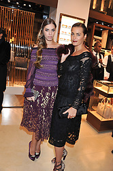 Left to right, AMBER LE BON and YASMIN LE BON at the Salvatore Ferragamo Old Bond Street Boutique Store Launch on 5th December 2012.