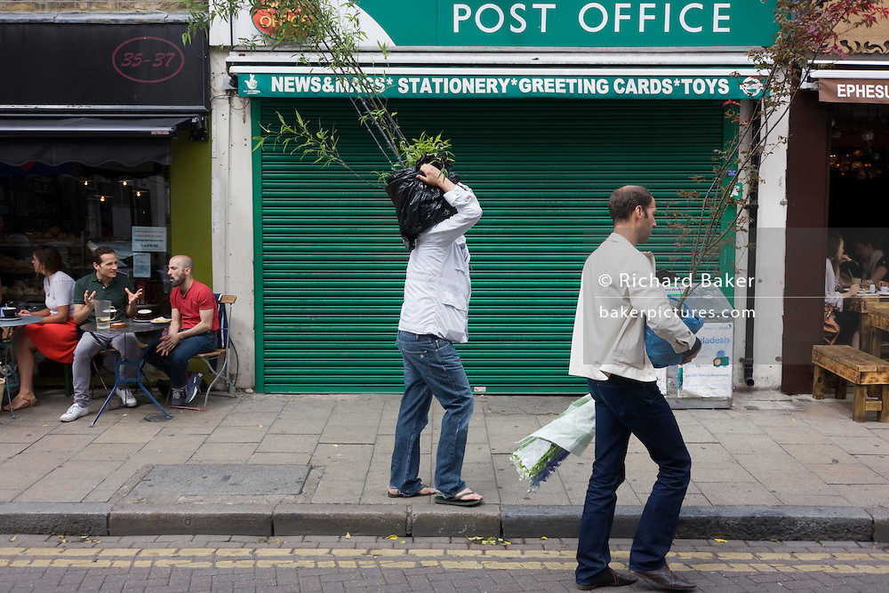 Carrying plants through the popular Broadway Market, a gentrified area of the otherwise poor borough of Hackney and Haggerston.