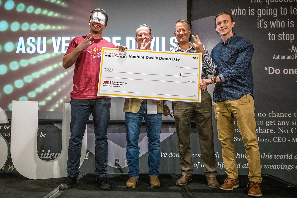 SCOTTSDALE - Nov. 30, 2018 - ASU Now - Venture Devils Demo Day - AudioLex's Ilya Skolkov, left, and Patrick Kennedy, right, pose with John and Joe Ashton, after being awarded a $5000 prize for their speech pathology program at the Venture Devils Demo Day awards ceremony at SkySong, Friday, November 30, 2018. Ninety-one top ASU-affiliated ventures in several categories earlier delivered investor-style pitches as they competed for over $250K in funding and support across multiple funding tracks through ASU's Entrepreneurship + Innovation. Photo by Charlie Leight/ASU Now