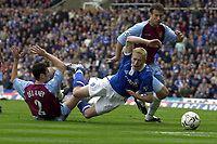 Picture: Henry Browne.<br />Date: 19/10/2003.<br />Birmingham City v Aston Villa FA Barclaycard Premiership.<br />Mark Delaney of Villa brings down Mikael Forssell of City in the area, but no penalty is given