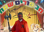 A boy of 9 dresses up as a Red daemon for purim